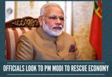 Officials look to PM Modi to rescue economy